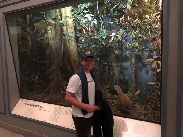 Adam in front of a display in the Hall of World Birds